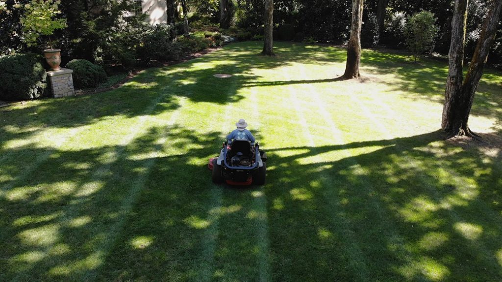 Livingscapes Landscaping Employee on Lawn Mower